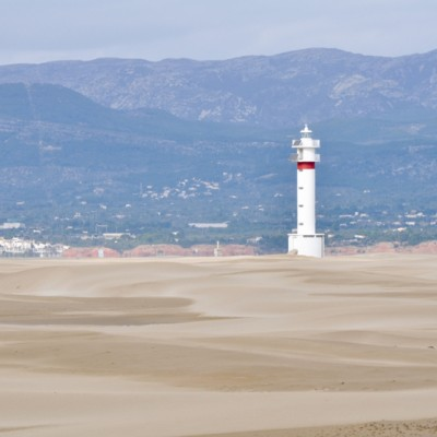 Lighthouse and sand dunes in Punta del Fangar