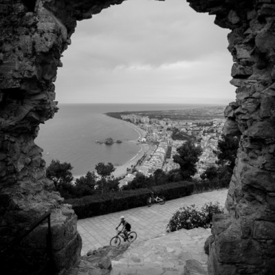 Blanes Views Stone Archway To Sea and Cyclist