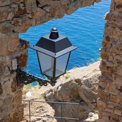 Old Town in Tossa de Mar, Costa Brava, Catalonia street lamp view to sea