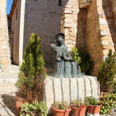 Sant Mateu Church Statue and offerings outside