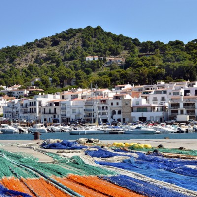 Harbor El Port de la Selva in Spain with multicolor fishing nets