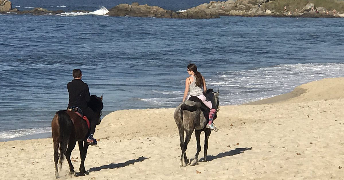 Galicia Spain travel guide horse riding on beach